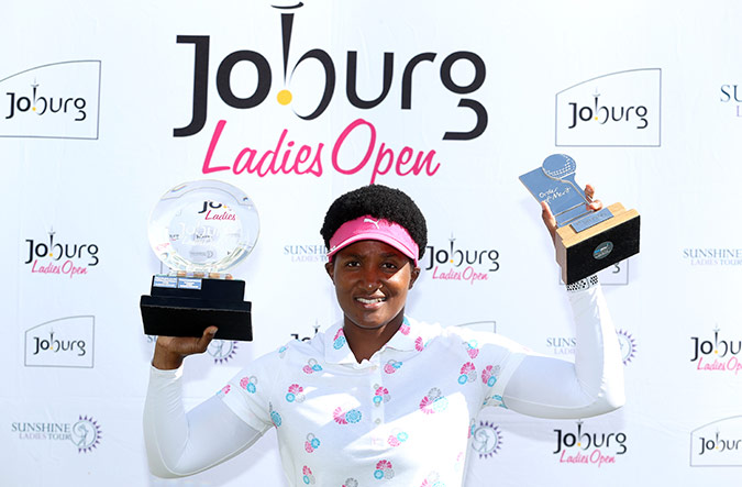 Dlamini with her winners trophies